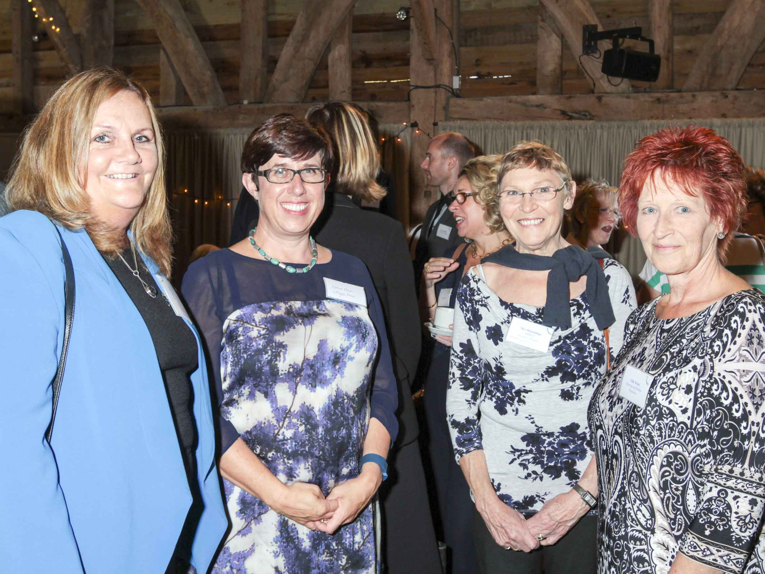 Four women at an event at Michelham Priory