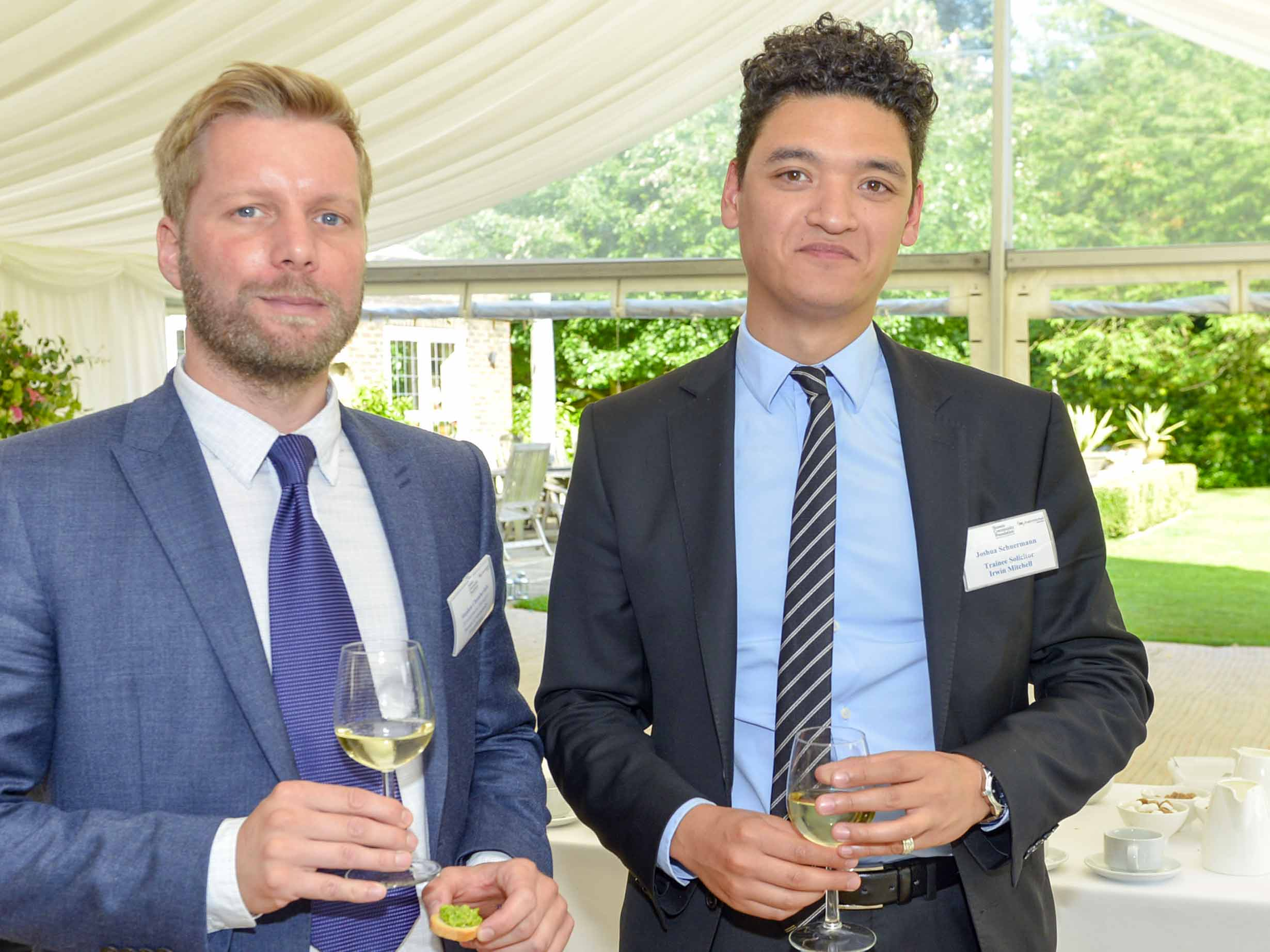 Professional advisors and Stephen at an event in the summer